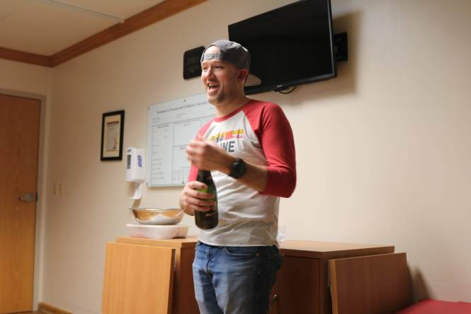 Dad Jesse popping champagne to celebrate baby Harrison