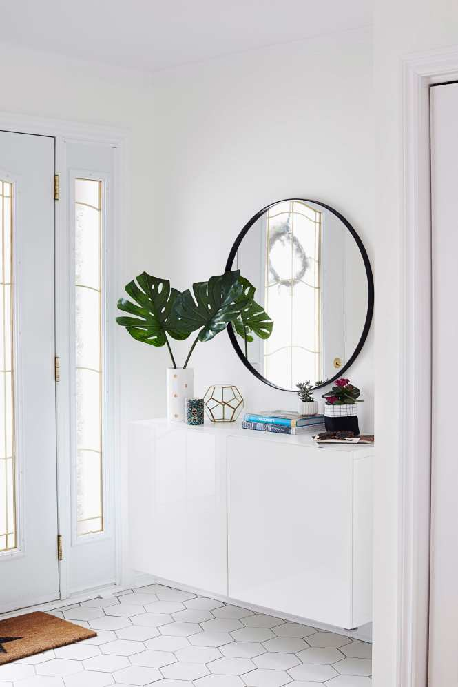 Floating Entryway Storage - Apartment Therapy_Tour a Colorful and Bright Home of a Family of Four in Montreal_