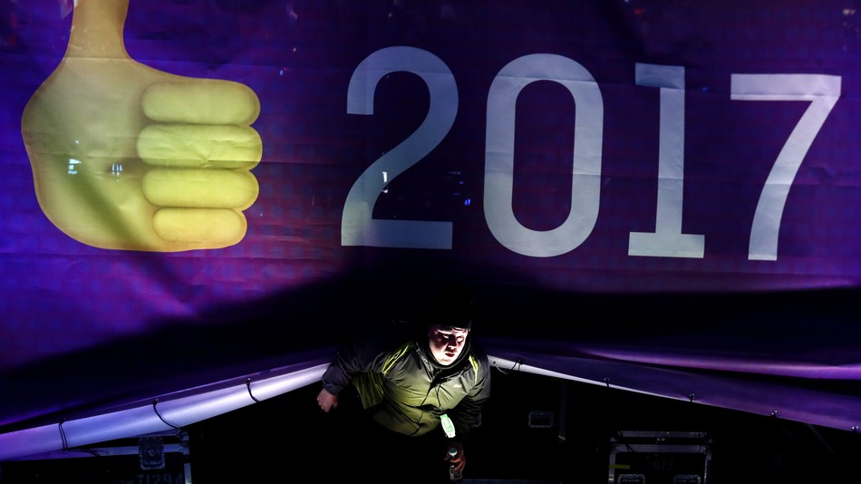 "Mashable: ""A crew member walks from under the main stage during the New Year's Eve celebration at Times Square, Saturday, Dec. 31, 2016, in New York."""
