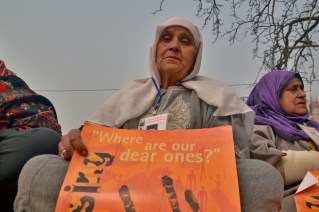 A Kashmiri woman whose relative has gone missing holds a placard at a protest marking International Human Rights Day in Srinagar, Indian administered kashmir on Dec 10, 2016