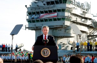 FILE - In this May 2, 2003 file photo, President George W. Bush declares the end of major combat in Iraq as he speaks aboard the aircraft carrier USS Abraham Lincoln off the California coast. George W. Bush knows that history will shape his legacy more than anything he can say. But that's not gonna stop a guy from trying. After two years of near silence, Bush is back. With his new memoir and a promotion tour, the president who in cockier times could not think of a single mistake he had made, lists many. (AP Photo/J. Scott Applewhite, File)
