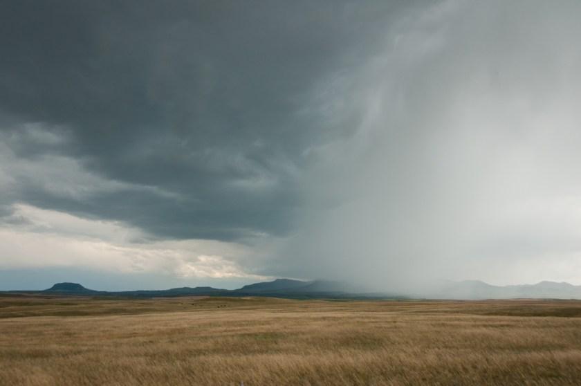 Rain sweeps the prairie as we steer our way toward Highwood
