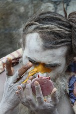 Sadhu applying his adornment