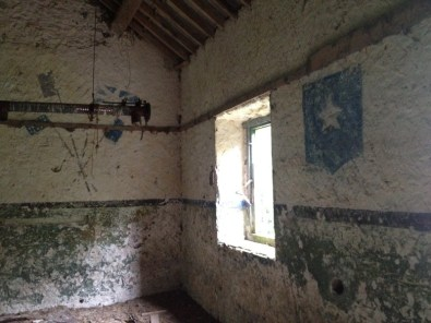 The upper floor showing preserved WW2 graffiti details.