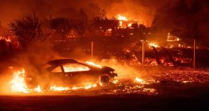 California wildfires: Malibu, home to Hollywood stars, burn as death toll rises