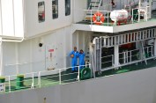 This ship's crew enjoyed taking pictures of the tourists who were taking pictures of them.
