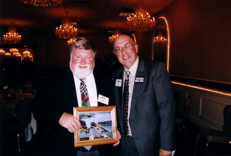 An award for three decades of race announcing from Joe Taylor of the Quad-Cities Convention and Visitors Bureau.