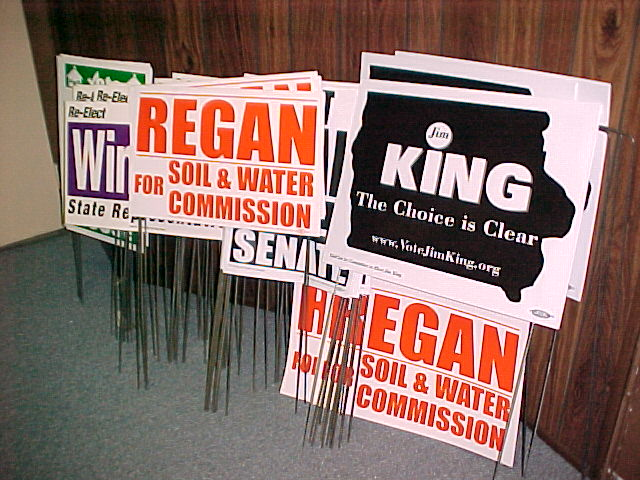 Should media people support candidates financially or display their signs?