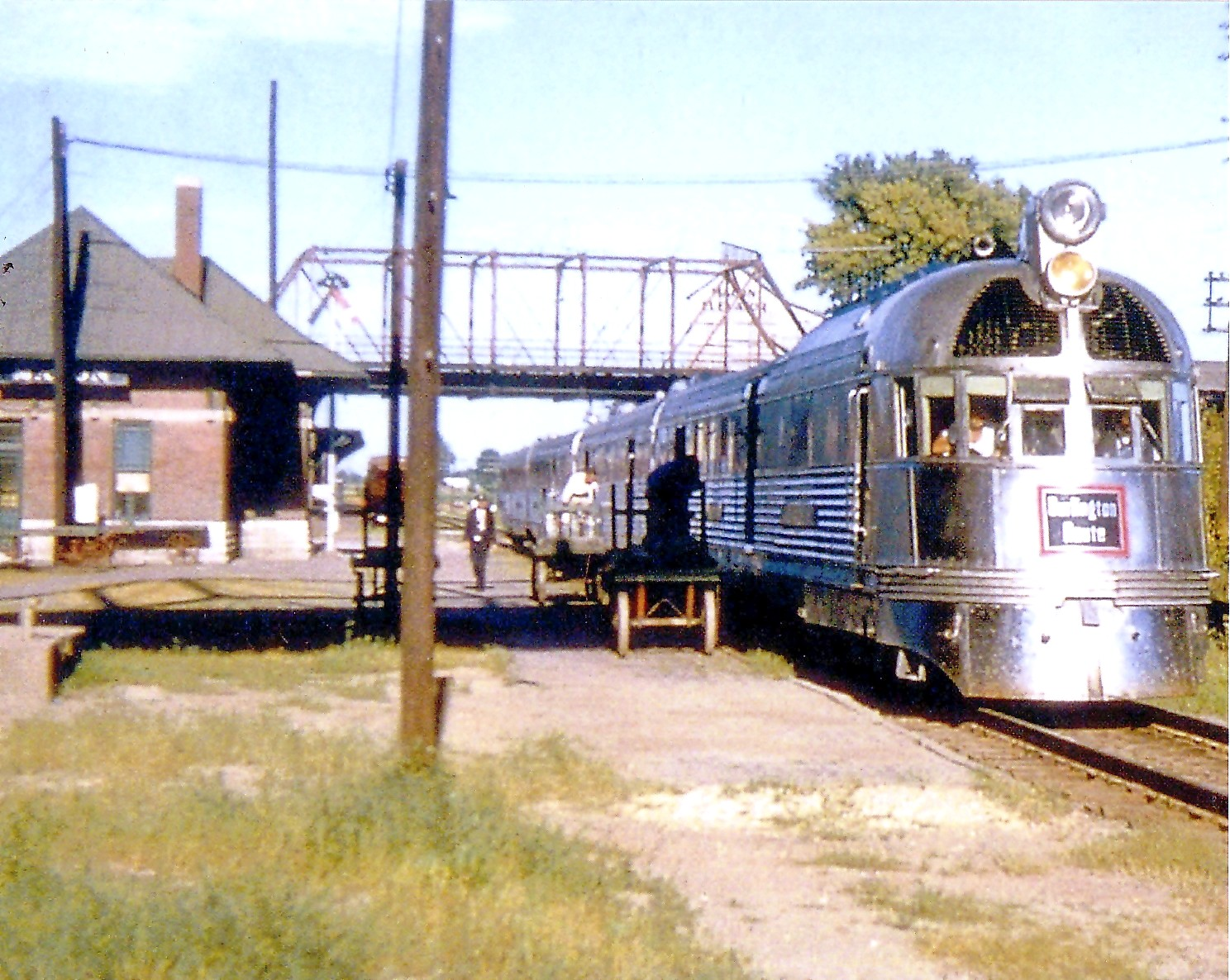 """CB&Q Railroad's (Burlington Route) Mark Twain Zephyr """"Injun Joe,"""" as photographed in July 1957 in Macon, Mo. Photo from the Phil Roberts Collection."""