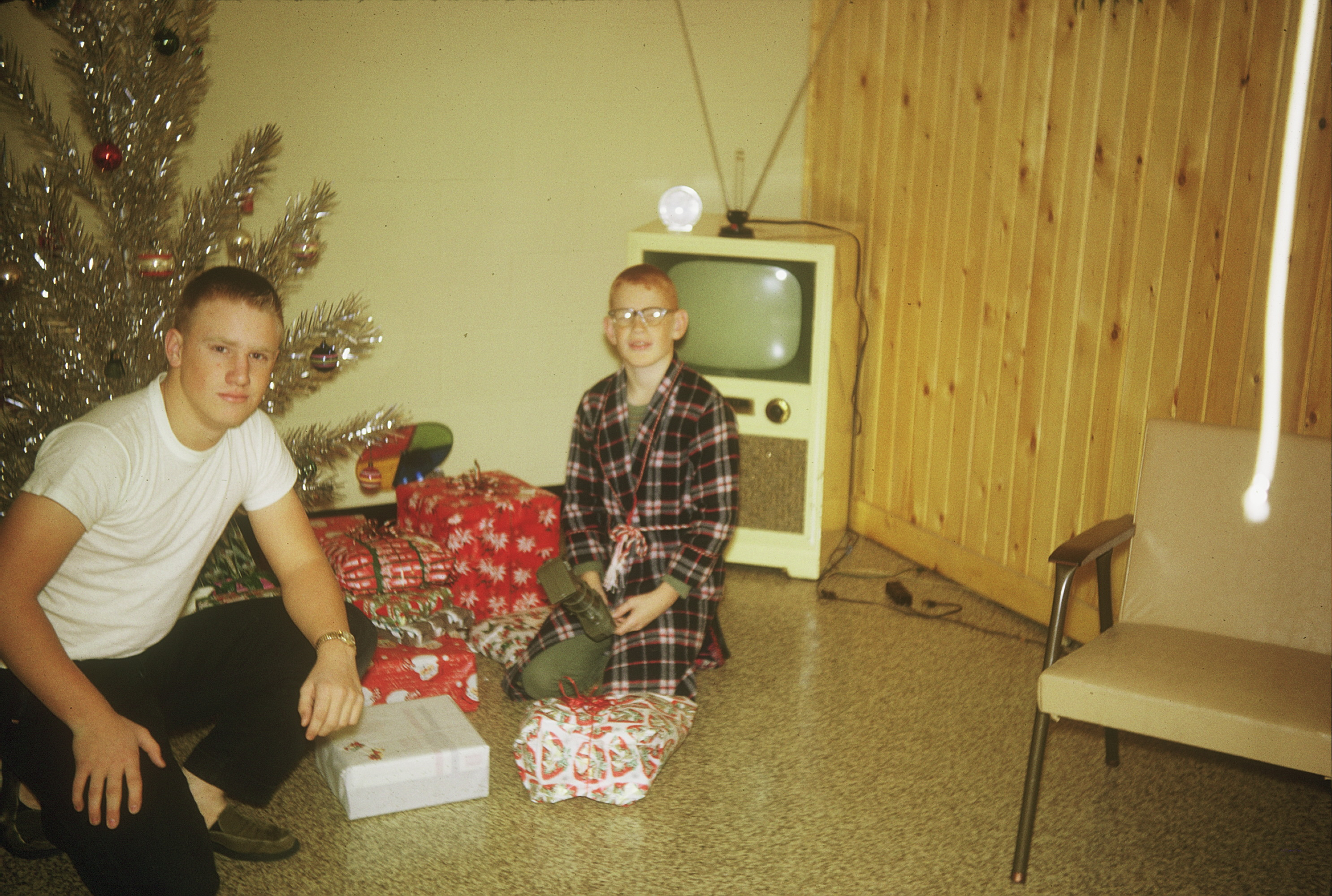 With my brother, Bruce, at Christmas 1963. We're in the basement because our dad so loved Christmas he often put up two trees, one in the living room and one in the basement family room. He also took this picture. I must have trained him how to do it off center.
