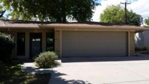 Ranch Style Gray Garage door