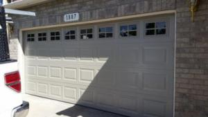 Insulated Steel, traditional style garage door with decorative windows