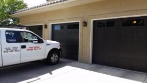 Three dark brown Carriage Style garage door with decorative windows