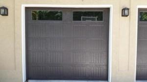 Dark Brown Carriage Style garage door with decorative windows
