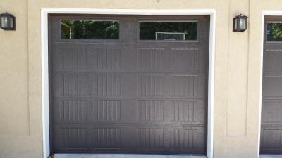 Dark Brown Carriage Style garage door with decorative windows