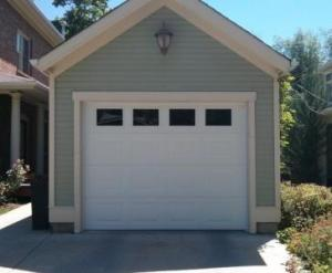 Small White Insulated Steel, traditional style garage door with decorative windows