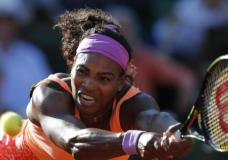 FILE - In this June 4, 2015, file photo, Serena Williams, of the United States, returns a shot in her semifinal match of the French Open tennis tournament against Timea Bacsinszky, of Switzerland, at the Roland Garros stadium in Paris. Williams withdrew from her opening match at the Hopman Cup on Monday, Jan. 4, 2016 because of inflammation in her left knee, an early setback in her preparations for an Australian Open title defense. (AP Photo/Francois Mori, File)