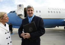 """U.S. Secretary of State, John Kerry, is greeted by the US Ambassador to Austria, Alexa Wesner, left, as he steps from his plane Saturday, Jan. 16, 2016, upon his arrival in Vienna, Austria on what is expected to be """"implementation day,"""" the day the International Atomic Energy Agency (IAEA) verifies that Iran has met all conditions under the nuclear deal. (Kevin Lamarque/Pool Photo via AP)"""