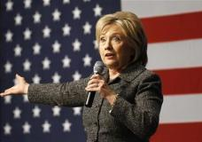 In this Jan. 12, 2016, photo, Democratic presidential candidate Hillary Clinton speaks during a campaign event at Iowa State University in Ames, Iowa. Challenged anew by Bernie Sanders, Clinton is reverting to some of the same themes, even strikingly similar attack lines, from her 2008 primary loss to Barack Obama. (AP Photo/Patrick Semansky)