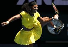 Serena Williams of the United States lifts her leg during their first round match against Camila Giorgi of Italy at the Australian Open tennis championships in Melbourne, Australia, Monday, Jan. 18, 2016.(AP Photo/Vincent Thian)