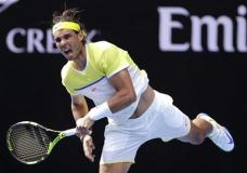 Rafael Nadal of Spain serves to compatriot Fernando Verdasco during their first round match at the Australian Open tennis championships in Melbourne, Australia, Tuesday, Jan. 19, 2016.(AP Photo/Aaron Favila)