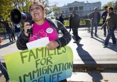 """FILE - In this Nov. 20, 2015 file photo, Ingrid Vaca, originally of Bolivia speaks during rally for immigration reform in front of the White House in Washington. The Supreme Court has agreed to an election-year review of President Barack Obama's executive orders to allow up to 5 million immigrants to """"come out of the shadows"""" and work legally in the U.S. (AP Photo/Jacquelyn Martin, File)"""