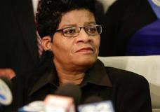 """Geneva Reed-Veal, mother of Sandra Bland, listens as attorney for the family Cannon Lambert speaks at a news conference Thursday, Jan. 7, 2016, in Chicago. The family of Bland, who was found dead in a Texas jail cell after a traffic stop in July, says a perjury charge against the white state trooper who pulled her over is """"not justice."""" An emotional Geneva Reed-Veal told reporters that the trooper should have been charged with battery and false arrest, adding that she has no confidence in the investigation and justice process. (AP Photo/Teresa Crawford)"""