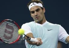 Roger Federer of Switzerland plays a shot in his quarterfinal game against Grigor Dimitrov of Bulgaria during the Brisbane International tennis tournament in Brisbane, Australia, Friday, Jan. 8, 2016. (AP Photo/Tertius Pickard)