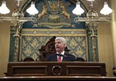 Michigan Gov. Rick Snyder delivers his State of the State address to a joint session of the House and Senate, Tuesday, Jan. 19, 2016, at the state Capitol in Lansing, Mich. (AP Photo/Al Goldis)