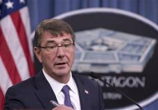 FILE - In this Dec. 11, 2015 file photo, Defense Secretary Ash Carter speaks to reporters at the Pentagon. Carter laid out broad plans Wednesday, Jan. 13, 2016, to defeat Islamic State militants and retake the group's key power centers in Iraq and Syria. And he announced that a special commando force has now arrived in Iraq. (AP Photo/Manuel Balce Ceneta, File)