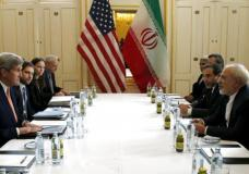 """U.S. Secretary of State John Kerry (L) meets with Iranian Foreign Minister Mohammad Javad Zarif on what is expected to be """"implementation day,"""" the day the International Atomic Energy Agency (IAEA) verifies that Iran has met all conditions under the nuclear deal, in Vienna January 16, 2016.  REUTERS/Kevin Lamarque"""