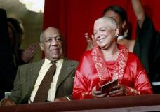 FILE - This Oct. 26, 2009 file photo, comedian Bill Cosby, left, and his wife Camille appear at the John F. Kennedy Center for Performing Arts before Bill Cosby received the Mark Twain Prize for American Humor in Washington. A judge has denied a request by lawyers for Bill Cosby's wife to postpone her deposition in a defamation lawsuit brought by seven women who claim the comedian sexually assaulted them. The judge ruled late Sunday, Feb. 20, 2016, that the deposition, scheduled for Monday, can proceed. (AP Photo/Jacquelyn Martin, File)