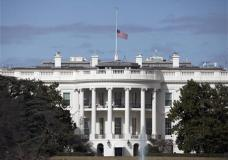 The flag flies at half-staff atop the White House in Washington, Tuesday, Feb. 16, 2016, in honor of Supreme Court Justice Antonin Scalia who died Saturday at age 79. (AP Photo/Carolyn Kaster)