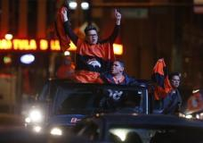Denver Broncos fans celebrate the team's victory over the Carolina Panthers in Super Bowl 50 near intersection of 15th and Champa Street late Sunday, Feb. 7, 2016, in Denver. (AP Photo/David Zalubowski)