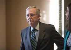 Senate Majority Leader Mitch McConnell walks to his office from the chamber where he offered a tribute to the late Supreme Court Justice Antonin Scalia whose death has triggered an election-year political standoff, on Capitol Hill in Washington, Monday, Feb. 22, 2016. (AP Photo/J. Scott Applewhite)