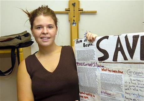 FILE - In this May 30, 2013, file photo, Kayla Mueller is shown after speaking to a group in Prescott, Ariz. The wife of a former senior leader of the Islamic State has been charged in federal court with contributing to the death of Mueller. The Justice Department on Feb. 8, 2016 announced charges against 25-year-old Nisreen Assad Ibrahim Bahar, who's also known as Umm Sayyaf. (AP Photo/The Daily Courier, Jo. L. Keener, File)