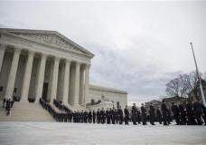 The body Supreme Court Justice Antonin Scalia arrives at the Supreme Court in Washington, Friday, Feb. 19, 2016. Thousands of mourners will pay their respects Friday for Justice Antonin Scalia as his casket rests in the Great Hall of the Supreme Court, where he spent nearly three decades as one of its most influential members. (AP Photo/Evan Vucci)