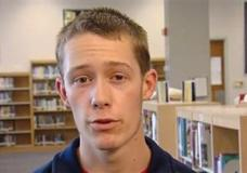 In this image made from video and provided by WMAR-TV, in Baltimore, David Eisenhauer conducts an interview discussing his athletic and academic aspirations for a weekly feature on high school athletes in the Baltimore area. Now the subject of shocking murder charges. Eisenhauer, an 18-year-old freshman engineering student and distance runner at Virginia Tech, is jailed without bond on charges of kidnapping and fatally stabbing a 13-year-old girl. (WMAR-TV via AP)