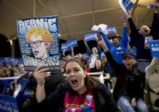 Sara Watts, center, and other supporters cheer for Democratic presidential candidate Sen. Bernie Sanders, I-Vt., while waiting for the arrival of Sen. Sanders at a rally Friday, Feb. 19, 2016, in Henderson, Nev. (AP Photo/Jae C. Hong)