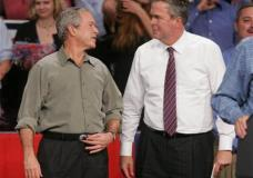 FILE - In this Nov. 6, 2006, file photo, President George W. Bush jokes with his brother Florida Gov. Jeb Bush in Pensacola, Fla., where the president was drumming up support for local Republican candidates. Jeb Bush is summoning his brother, former President George W. Bush, to campaign for him in South Carolina. It's not without risks, but the Bush family has long, deep political ties in the state, and the former Florida governor has little choice if he wants to join his father and brother as Oval Office occupants. (AP Photo/Mari Darr-Welch, File)