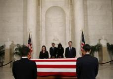 U.S. President Barack Obama (C-L) and first lady Michelle Obama (C-R) visit the casket of late U.S. Supreme Court Justice Antonin Scalia in the Supreme Court's Great Hall in Washington February 19, 2016. REUTERS/Kevin Lamarque