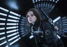 "FILE - This file image released by Lucasfilm Ltd. shows Felicity Jones as Jyn Erso in a scene from, ""Rogue One: A Star Wars Story."" The ""Star Wars"" spinoff ""Rogue One"" has led the box office for the third straight week, taking in an estimated $64.3 million over the four-day New Year's weekend. (Jonathan Olley/Lucasfilm Ltd. via AP, File)"