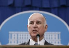 FILE - In this Jan. 10, 2017, file photo, California Gov. Jerry Brown discusses his 2017-2018 state budget plan he released at a news conference in Sacramento, Calif. Brown is coming off a blockbuster year of liberal wins on climate change, minimum wage, gun control and two of his pet projects, sentencing reform and high-speed rail. But he delivers his State of the State address Tuesday, Jan. 24 in a time of uncertainty for California and to a Legislature that's in a defensive posture after the election of President Donald Trump. (AP Photo/Rich Pedroncelli, File)