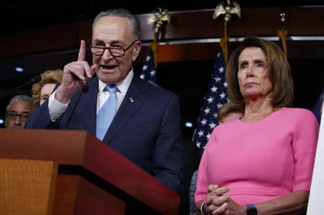 Senate Minority Leader Charles Schumer of N.Y., accompanied by House Minority Leader Nancy Pelosi of Calif., speaks during a news conference about President Barack Obama's signature healthcare law, Wednesday, Jan. 4, 2017, on Capitol Hill in Washington. (AP Photo/Evan Vucci)