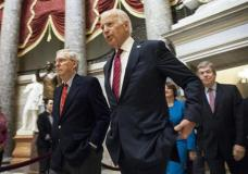 Senate Majority Leader Mitch McConnell (R-Ky.), left, and Vice President Joe Biden walk through Statuary Hall on their way to a joint session of Congress to count the votes in Washington, Friday, Jan. 6, 2017. It's official: Congress has tallied the Electoral College votes and Donald Trump has been elected president. (AP Photo/Zach Gibson)