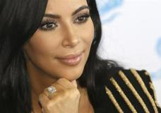 FILE - In this June 24, 2015 file photo, American TV personality Kim Kardashian attends the Cannes Lions 2015, International Advertising Festival in Cannes, southern France. Paris police Monday Jan.9, 2017 say 16 people have been arrested over Kim Kardashian jewelry heist. (AP Photo/Lionel Cironneau, File)