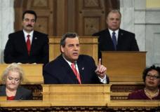 FILE- In this Jan. 12, 2016, file photo, Assembly Speaker Vincent Prieto, D-Secaucus, N.J., back left, and Senate President Stephen M. Sweeney, back right, D-West Deptford, N.J., listen as New Jersey Gov. Chris Christie delivers his State of the State address in the Statehouse in Trenton, N.J. Christie will deliver his seventh state of the state address next week ahead of his final year in office. (AP Photo/Mel Evans, File)
