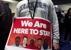 Immigrant rights advocates demonstrate against President-elect Donald Trump's immigration policies, during a rally at Metropolitan AME Church in Washington, Saturday, Jan. 14, 2017. ( AP Photo/Jose Luis Magana)