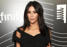 """FILE - In this May 16, 2016 file photo, Kim Kardashian West attends the 20th Annual Webby Awards in New York. Kardashian who has been laying low in a New York City apartment building since her robbery at gunpoint in Paris in October, breaks her silence in a new teaser for the family's reality show, """"Keeping Up with the Kardashians,"""" returning in March. (Photo by Andy Kropa/Invision/AP, File)"""