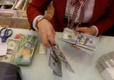 A woman counts U.S. dollars at a bank in Ho Chi Minh City, Vietnam, January 10, 2017. REUTERS/Kham